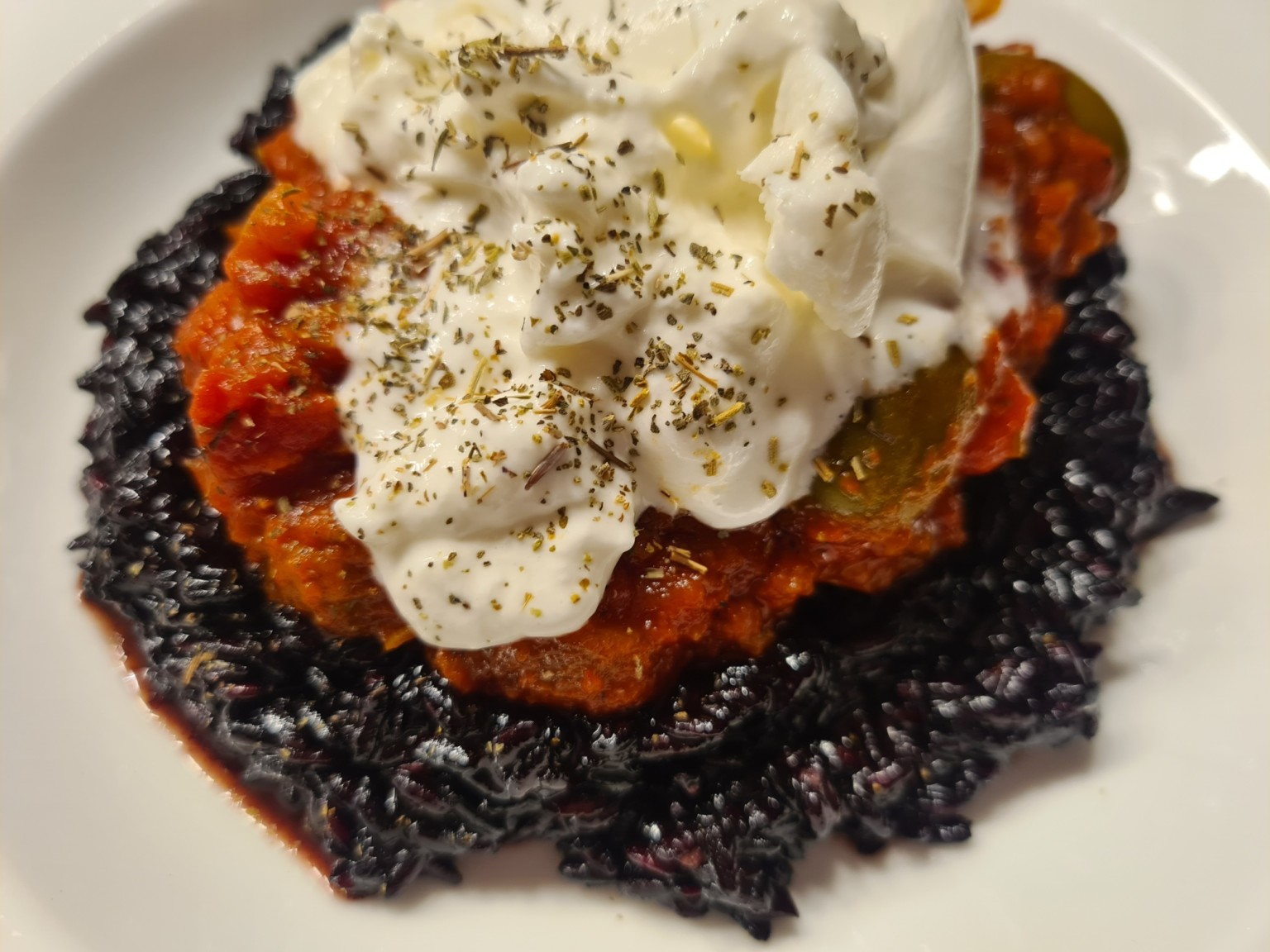 Venere-Risotto mit Burrata Tomaten